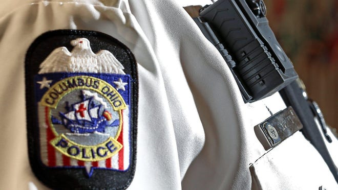 A Columbus police officer is shown wearing a body camera.