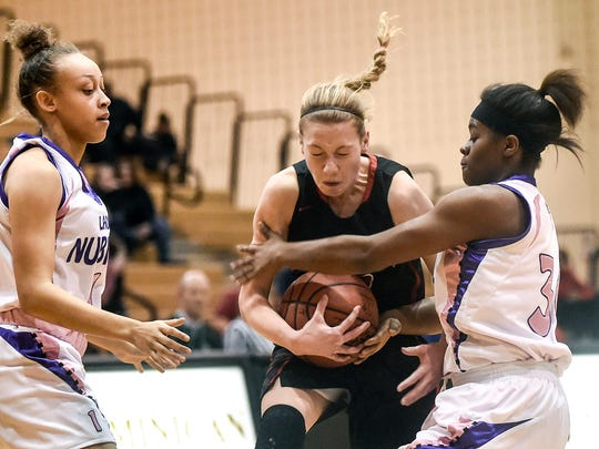Cardington's Sage Brannon attempts to break through Africentric's defense during the Division III district final girls basketball game  at Ohio Dominican University last season. Brannon is among the four starters returning for the Pirates this season.