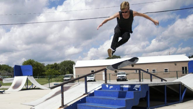 Kieth D'Amato, 16, performs a trick at the Plymouth skate park on Aug. 1. D'Amato said he has not seen a big influx of skaters from Sheboygan at the park.