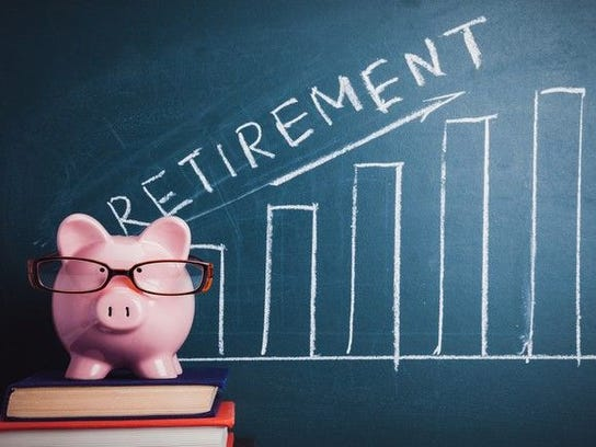 Piggy bank in front of blackboard on which is a rising bar graph and the word retirement