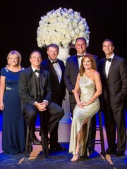 "The Maltz Jupiter Theatre invites you to its most magnificent fundraising event of the year, the annual gala ""Everything's Coming Up Roses,"" scheduled Saturday, Feb. 25, 2017, at Trump National Golf Club in Jupiter. From left are Pamela Dyar, Sal Tiano, Andrew Kato, John D. Couris, Michele Jacobs and Cressman Bronson."