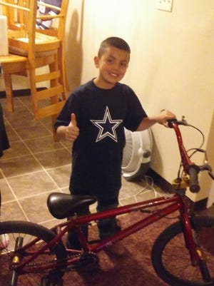Ivan Hernandez poses with his stolen bike that was retreived by the Santa Clara Police Department.
