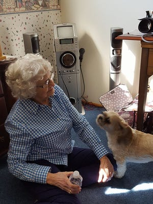 Sylvia Weibel with her dog, Rascal, and her karoke machine in her Hillview home.