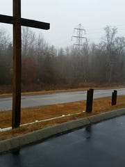 Two wooden crosses were cut down by a vandal early