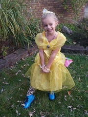 Italia McAllister is working hard at recovery after she lost her left foot in a lawnmower accident. She's pictured here before the accident in her favorite dress — Belle's from Beauty and the Beast.