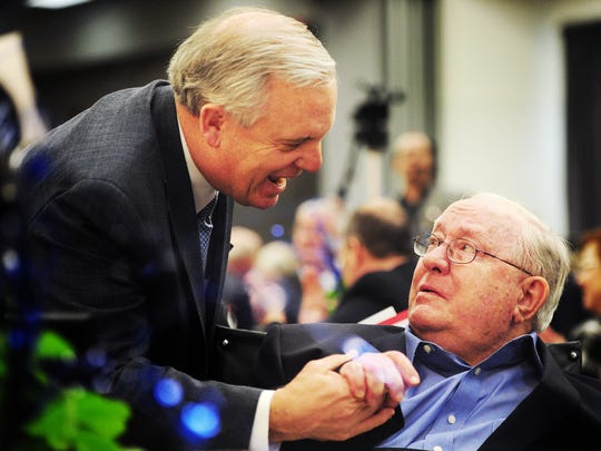 Mayor Norm Archibald honors Dr. William J. Teague for his contributions to the establishment of KACU during a luncheon to celebrate the 25th anniversary of the public radio station on 2012 at the then-Abilene Civic Center.