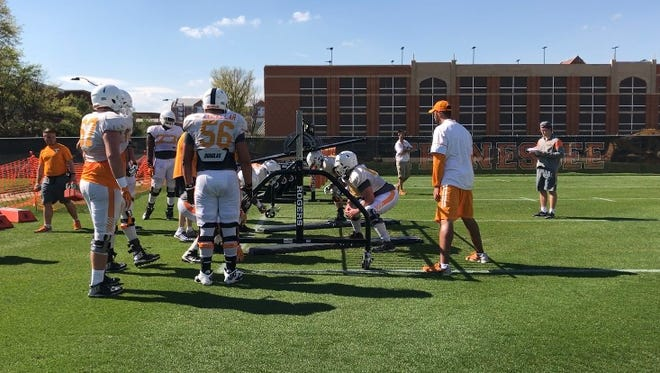 The offensive line goes through drills during Tennessee's 10th spring practice on Tuesday afternoon at Haslam Field.