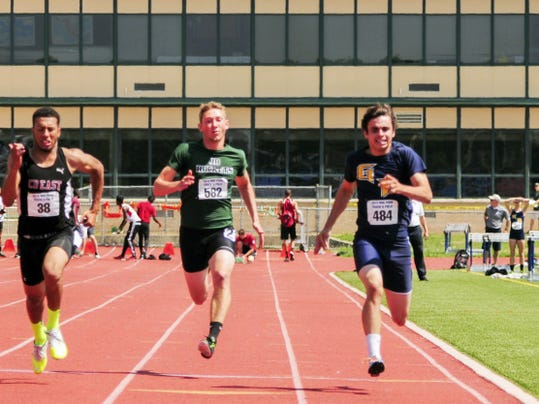 James Buchanan's Peter Hughey, center, and Greencastle's Liam Okal, right, compete in the 100 dash finals on Saturday at the Mid Penn Conference Championships. Hughey placed eighth, and Okal captured third.