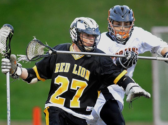 York Suburban's Kevin Moats defends Red Lion's Tanner Reif on Thursday at Suburban. Reif finished with a goal and four assists. Red Lion won the match, 9-8.