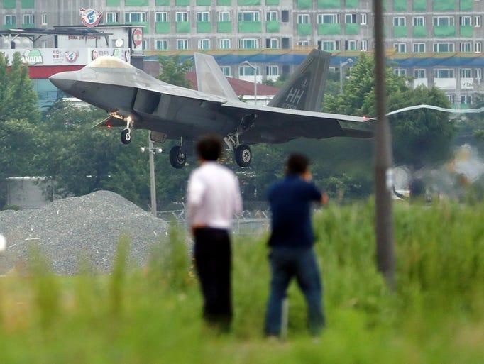 A U.S. F-22 Raptor stealth fighter jet lands as South