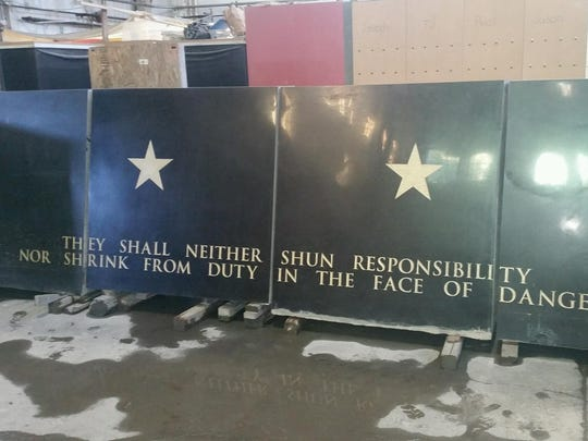 The basalt wall of the Oregon State Police Fallen Trooper Memorial is nearly finished at Jones Sculpting Studio in Portland.