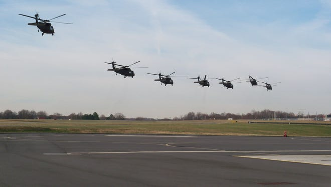 UH-60 Black Hawk helicopters from Company A, 3rd Battalion, 238th Aviation Regiment, Delaware Army National Guard leaving the state in late 2013 to begin training for deployment to Kuwait.