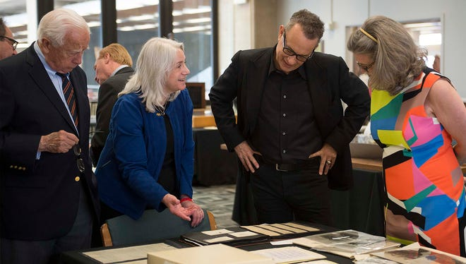 Dawne Dewey, head of Special Collections and Archives at Wright State, second from left, showed items from the university's Wright Brothers Collection to writer David McCullough, left, Tom Hanks and Amanda Wright Lane, great-grandniece of the Wright brothers. (Photo by Will Jones)