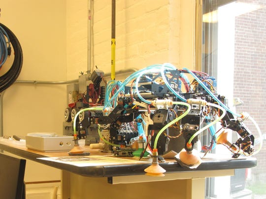 Tubing: A prototype wall-climbing robot sits motionless near a window at the Vibrations Laboratory at UVM School of Engineering.