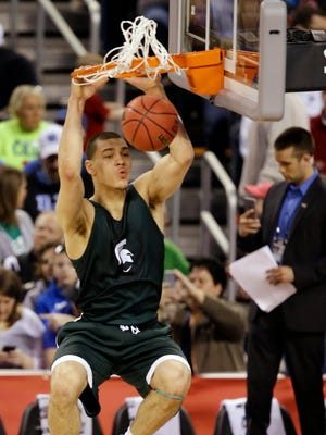 Michigan State's Gavin Schilling dunks during a practice session April 3, 2015, in Indianapolis.