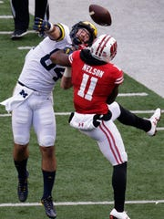 Wisconsin cornerback Nick Nelson  breaks up a pass intended for Michigan tight end Sean McKeon.