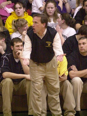 Colonel Crawford coach Steve Mohr questions one of his team members during a recent basketball game.