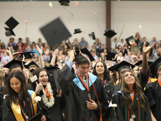 Tassels were turned and caps came off at the conclusion of the Central Kitsap High School Class of 2018 graduation on Friday, June 15, 2018 at the Kitsap Sun Pavilion.