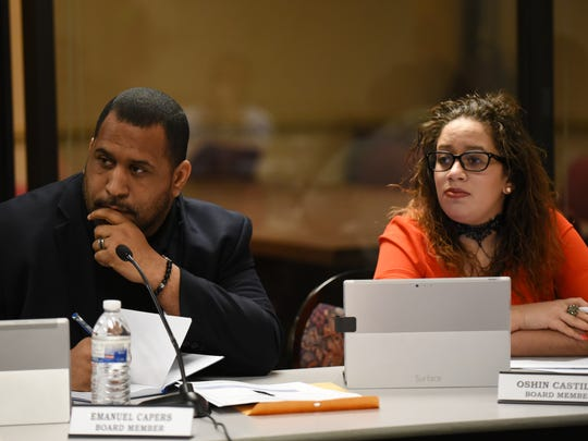 Emanuel Capers - Board Member and Oshin Castillo - Board Member listen to the concerns of those in the community.