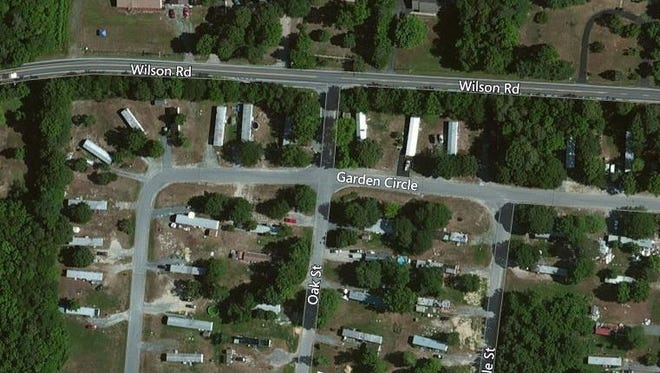 Preliminary investigation suggests the woman was struck by an unknown vehicle along Oak Street in the area of Garden Circle within the development.