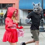Jerry Pardon, right, and Gretchen Vandergriff take part in a Knoxville Track Club Halloween costume fun run at Market Square on Wednesday, October 28, 2015. (SAUL YOUNG/NEWS SENTINEL)