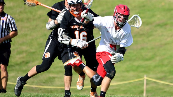 Champlain Valley's Jake Evans, wins the face-off and escapes with the ball during the boys lacrosse quarterfinals at Hinesburg on Friday. CVU won 11-4.
