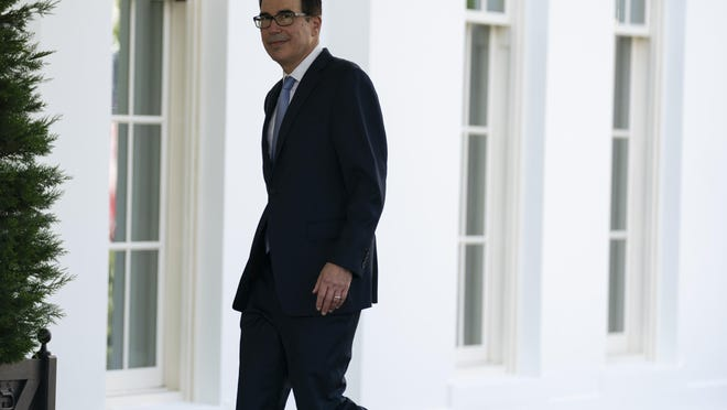 Treasury Secretary Steven Mnuchin walks past a group of reporters to a meeting at the White House, Thursday, July 9, 2020, in Washington.