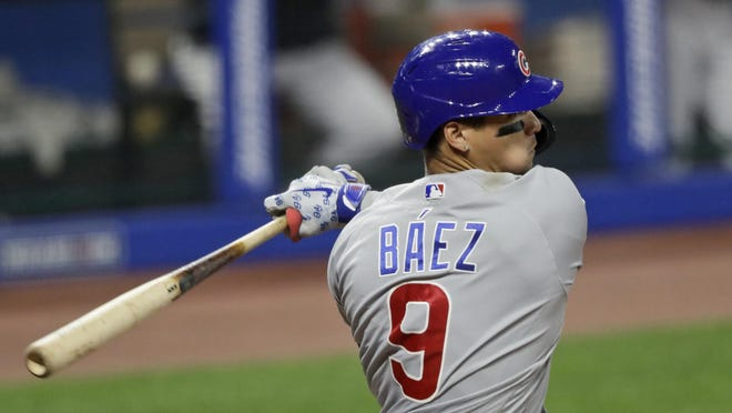 Chicago Cubs shortstop Javier Baez hits a single in the sixth inning of Tuesday's game against the Cleveland Indians, in Cleveland.