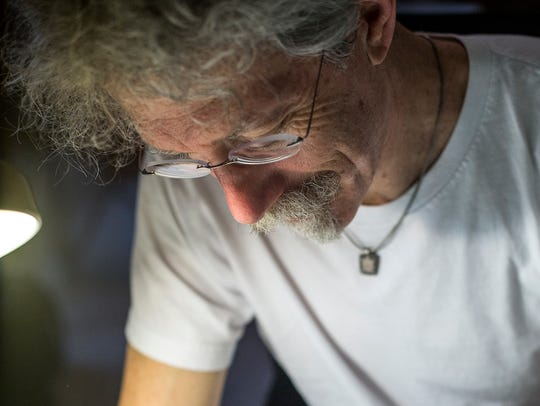 Asheville Citizen-Times cartoonist David Cohen sits