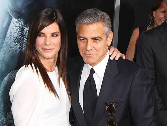 Sandra Bullock with George Clooney