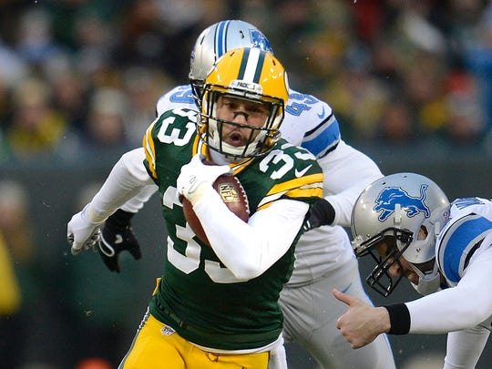 Green Bay Packers' Micah Hyde (33) returns a punt for a 55-yard touchdown during the Week 17 game against the Detroit Lions at Lambeau Field.