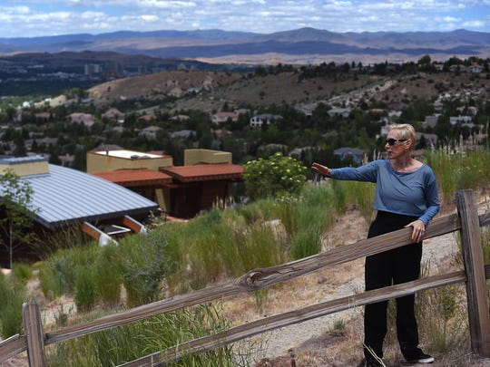 Homeowner Sharon Ing explains to the media what she witnessed at the start of a recent brush fire above Caughlin Ranch in Reno on June 16, 2016.