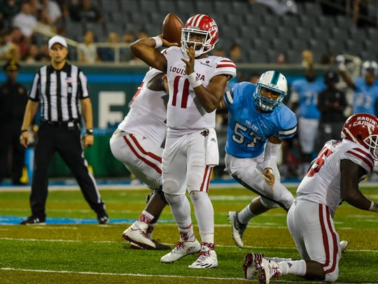 UL's Anthony Jennings throws over the middle during