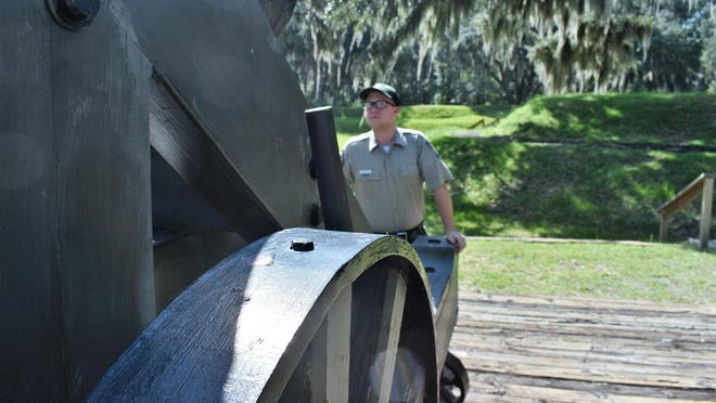 Assistant park manager Scott Smith inspects the working of a hot shot cannon at Fort McAllister State Park.
