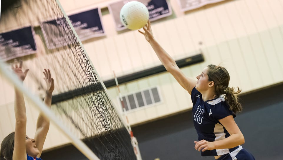 Shalom's Lauren Stains (18) hits the ball over the