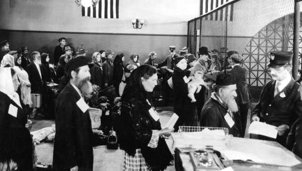 Jewish immigrants arriving at immigration office in Ellis Island in New York c. 1910.