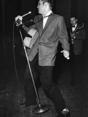 Elvis Presley performs May 15, 1958, in Memphis.