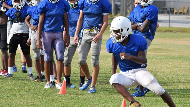 Evening football practice for the Titusville Terriers football team.