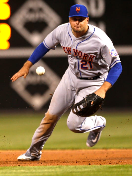 New York Mets first baseman Lucas Duda (21) gets ready to field a ground ball hit by Philadelphia Phillies' Michael Saunders (5) in the third inning of a baseball game, Monday, April 10, 2017, in Philadelphia. (AP Photo/Laurence Kesterson)