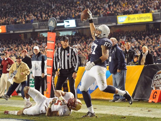 Penn State tight end Kyle Carter out of William Penn High catches a decisive touchdown pass over Boston College's Ty-Meer Brown at the 2014 Pinstripe Bowl at Yankee Stadium.