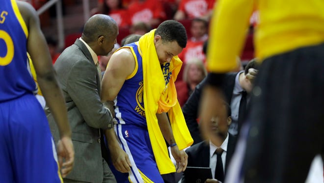 Curry heads off the court and to the locker room during Game 4.