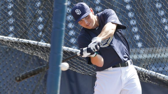 First round draft choice of the San Diego Padres, Hunter Renfroe, takes a batting practice at Petco Park after signing his contract before the Padres' baseball game against the Colorado Rockies in San Diego, Tuesday, July 9, 2013. (AP Photo/Lenny Ignelzi)