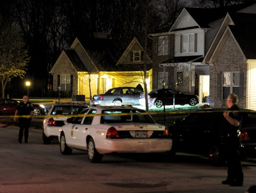 Police activity is seen April 17, 2014, at a home (right) in the 2400 block of Inishmore Court. A murder-suicide there involved two Indianapolis Metropolitan Police Department personnel. Sgt. Ryan Anders and Officer Kim Carmack were found dead about 5:40 p.m. inside the home. Anders and Carmack were an estranged husband and wife.
