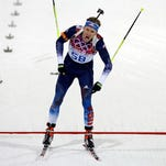 United States' Lowell Bailey crosses the finish line after the men's biathlon 20k individual race, at the 2014 Winter Olympics, Thursday, Feb. 13, 2014, in Krasnaya Polyana, Russia.
