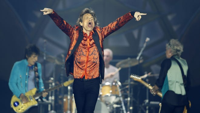 """Rolling Stones' Mick Jagger gets the crowd going during their """"Zip Code"""" tour at Ralph Wilson Stadium in Buffalo on July 11, 2015."""