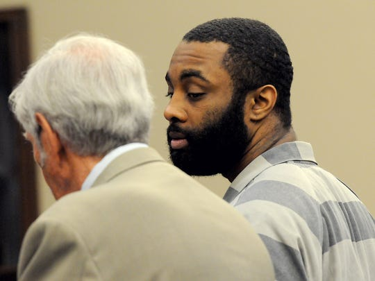 Jonathan Purnell, right, 28, talks with his attorney, Stuart Allen, Wednesday, August 19, 2015, in Judge Joyce Draganchuk's courtroom at the Ingham County Circuit Court.
