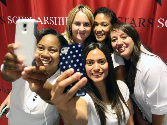 Lakesha Nelson, left, and Margie Muñoz, center, take a group selfie with fellow scholarship recipients from top left, Rena Moore, Mercedes Briddell and Brenda Gonzalez, during the El Paso Stars Extravaganza on Oct. 6 at the El Paso Convention Center. The event raised funds for the Stars Scholarship Fund, which provides college scholarships to El Paso-area students.
