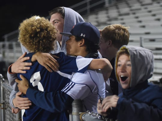 Chambersburg's Nathaniel Maynard (3) celebrates with fans after a win against Hempfield during District 3 playoff soccer on Tuesday, October 27, 2015.