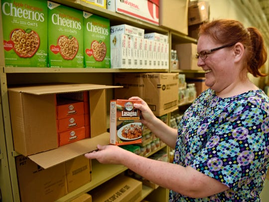 Melissa Stevens, pupils services secretary, unpacks boxes of donated food at the food pantry run by the Homeless Matters committee in the Chambersburg Area School District Administration Building,  on Thursday, September 15, 2016.