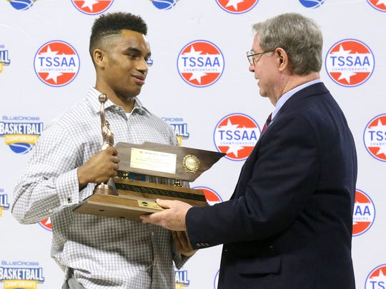 Chase Hayden is presented Mr. Basketball Trophy on